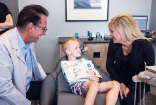 rockford dentist dr. hansen with patient and parent