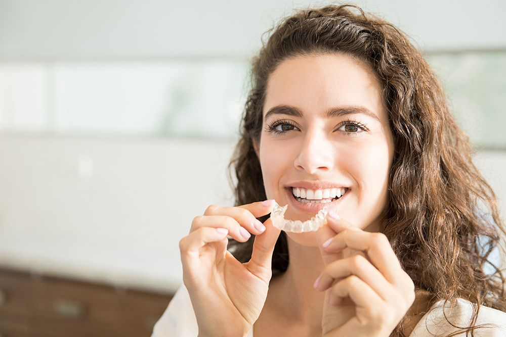 Rockford Invisalign Patient Putting on Clear Aligners