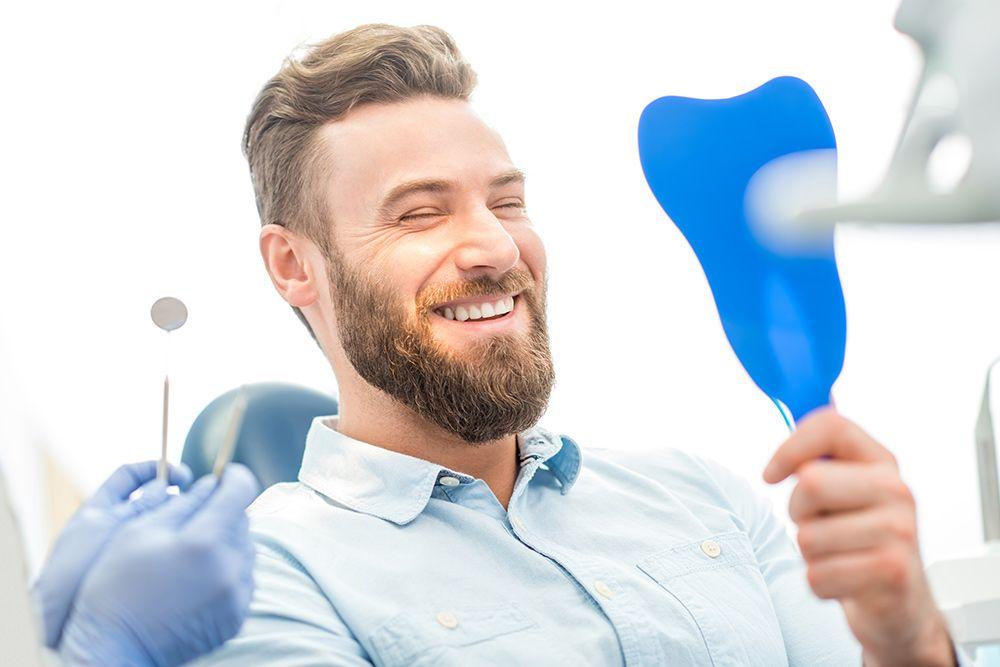 dental bonding patient looking into mirror
