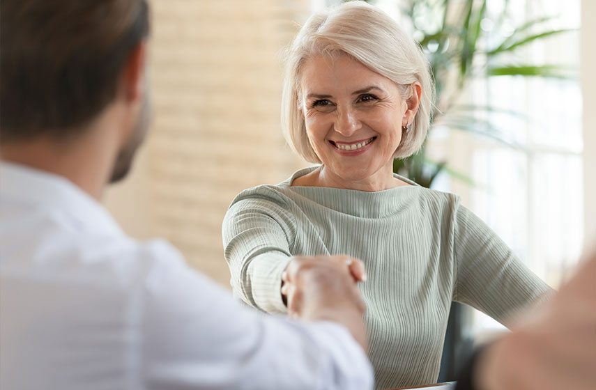 restortive dental patient shaking dentist hand