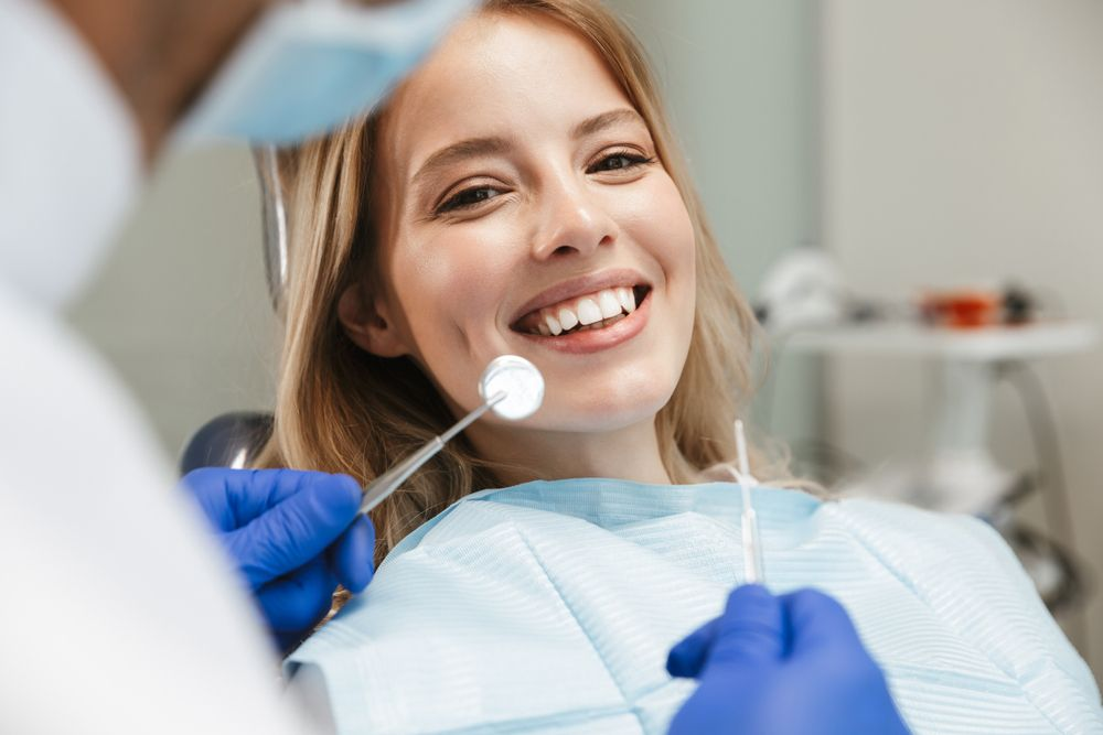 dentist preparing dental filling for patient
